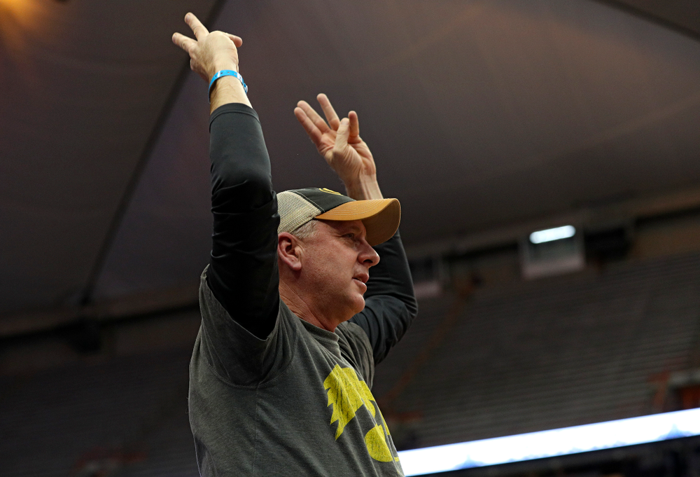 A Hawkeyes fans holds up three fingers in each after after an Iowa 3-pointer during the second half of their ACC/Big Ten Challenge game at the Carrier Dome in Syracuse, N.Y. on Tuesday, Dec 3, 2019. (Stephen Mally/hawkeyesports.com)