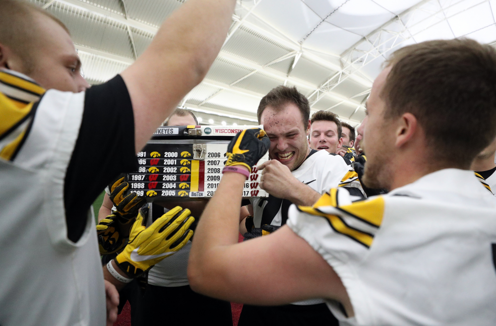 The Hawkeye football managers capture the rusty toolbox for the first time since 2008 with a 20-19 double The Hawkeye Football Managers captured the rusty toolbox for the first time since 2008 with a 20-19 double overtime win against the Wisconsin football managers on Nov. 8 in Madison, Wisconsin. (Brian Ray/hawkeyesports.com)
