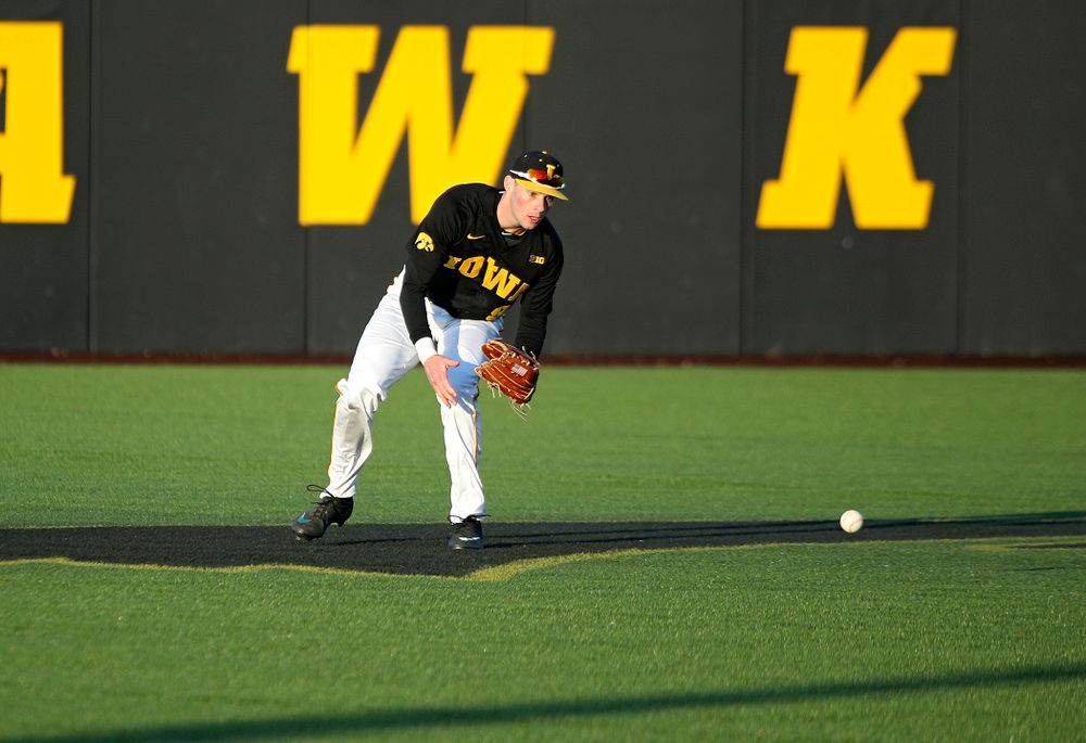 Iowa outfielder Ben Norman (9) fields a ball during the fifth inning of their game at Duane Banks Field in Iowa City on Tuesday, March 3, 2020. (Stephen Mally/hawkeyesports.com)