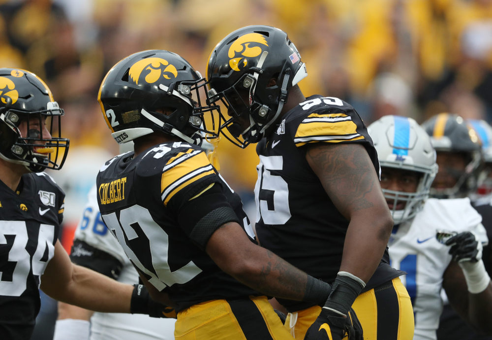 Iowa Hawkeyes defensive lineman Cedrick Lattimore (95) and linebacker Djimon Colbert (32) against Middle Tennessee State Saturday, September 28, 2019 at Kinnick Stadium. (Brian Ray/hawkeyesports.com)
