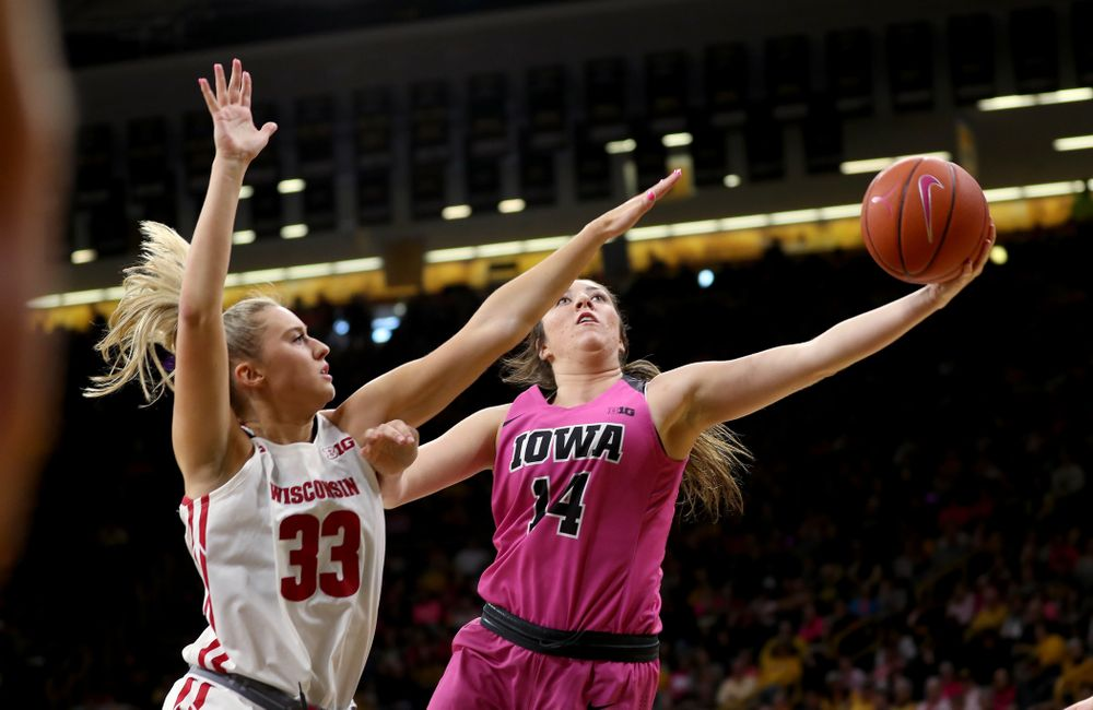 Iowa Hawkeyes forward McKenna Warnock (14) against the Wisconsin Badgers Sunday, February 16, 2020 at Carver-Hawkeye Arena. (Brian Ray/hawkeyesports.com)