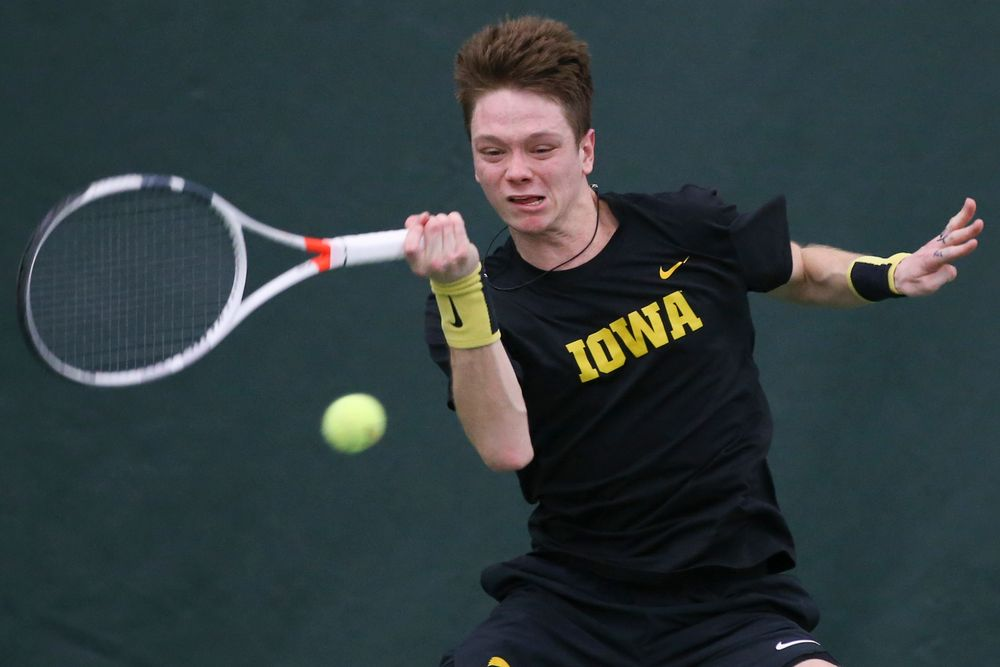 Iowa's Jason Kerst hits a forehand during the Iowa men's tennis meet vs VCU  on Saturday, February 29, 2020 at the Hawkeye Tennis and Recreation Complex. (Lily Smith/hawkeyesports.com)