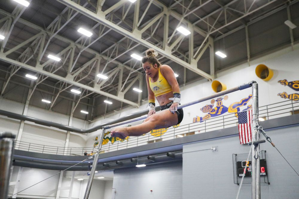 Maddie Kampschroeder performs on the uneven bars during the Iowa women's gymnastics Black and Gold Intraquad Meet on Saturday, December 7, 2019 at the UI Field House. (Lily Smith/hawkeyesports.com)
