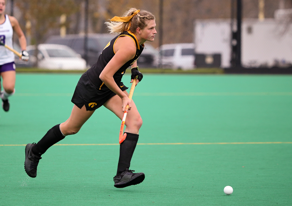 Iowa's Ellie Holley (7) looks down field as she moves with the ball during the third quarter of their game at Grant Field in Iowa City on Saturday, Oct 26, 2019. (Stephen Mally/hawkeyesports.com)