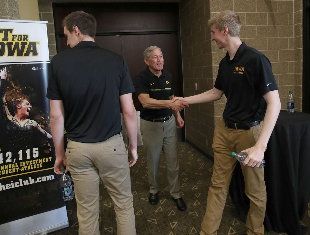 Nicholas Baer, Kirk Ferentz, Michael Baer -- Hawkeye Fan Event at the Quad-Cities Waterfront Convention Center in Bettendorf, Iowa, on May 15, 2019.