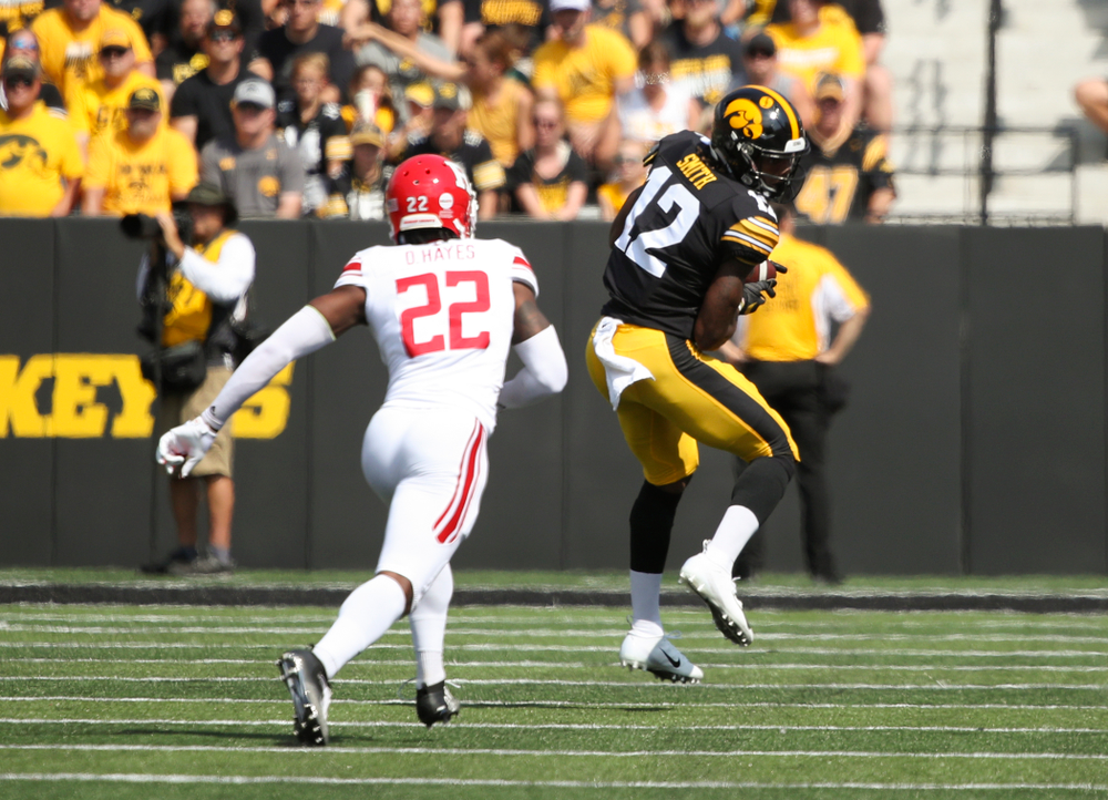 Iowa Hawkeyes wide receiver Brandon Smith (12) pulls in a pass during the first quarter of their Big Ten Conference football game at Kinnick Stadium in Iowa City on Saturday, Sep 7, 2019. (Stephen Mally/hawkeyesports.com)