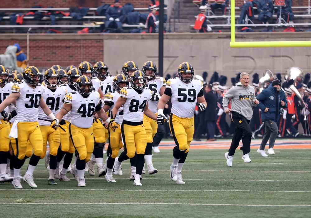 The Iowa Hawkeyes swarm onto the field for their game against the Illinois Fighting Illini Saturday, November 17, 2018 at Memorial Stadium in Champaign, Ill. (Brian Ray/hawkeyesports.com)