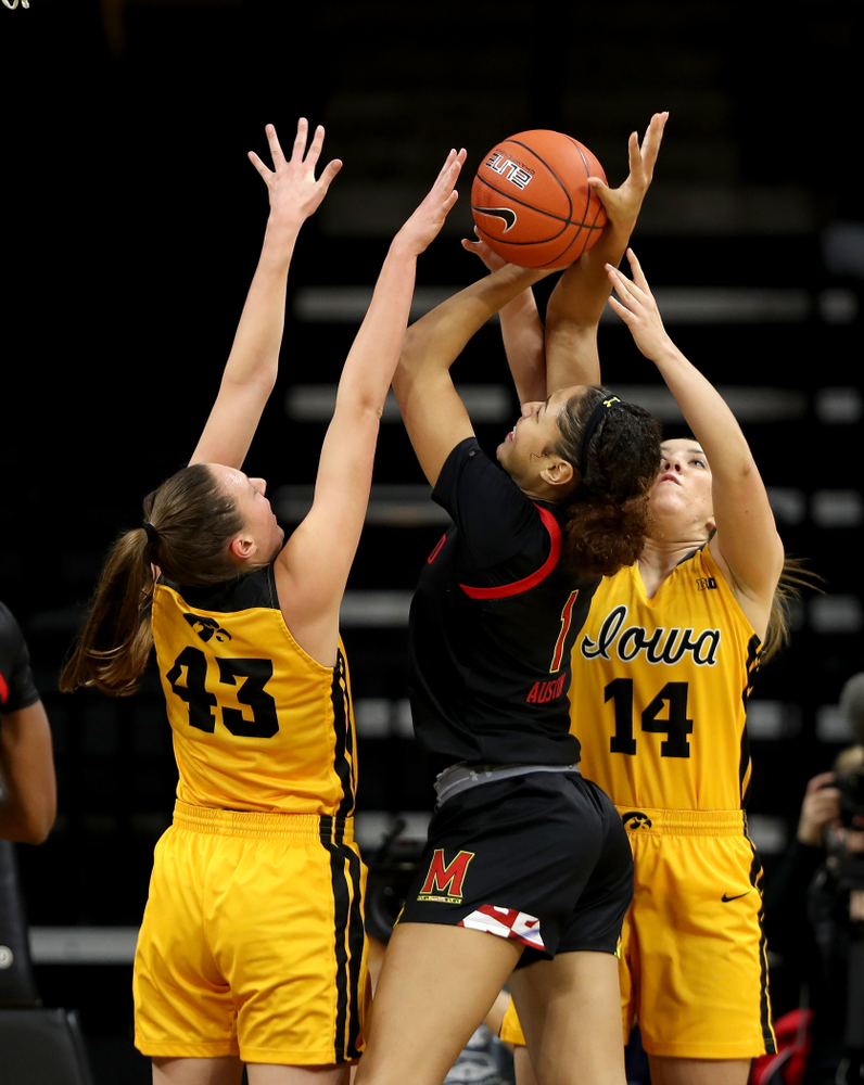 Iowa Hawkeyes forward Amanda Ollinger (43) blocks a shot against the Maryland Terrapins Thursday, January 9, 2020 at Carver-Hawkeye Arena. (Brian Ray/hawkeyesports.com)