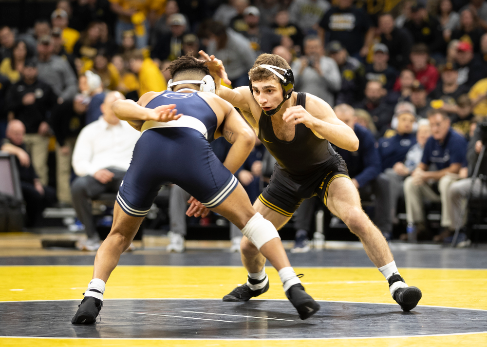 Iowa's Austin DeSanto wrestles Penn State's Roman Bravo-Young at 133 pounds Friday, January 31, 2020 at Carver-Hawkeye Arena. DeSanto Injury defaulted. (Brian Ray/hawkeyesports.com)