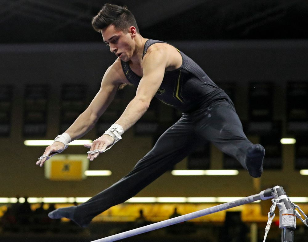 Iowa's Andrew Herrador competes in the horizontal bar during the first day of the Big Ten Men's Gymnastics Championships at Carver-Hawkeye Arena in Iowa City on Friday, Apr. 5, 2019. (Stephen Mally/hawkeyesports.com)