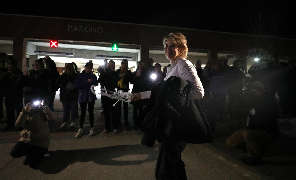 Iowa Hawkeyes head coach Lisa Bluder celebrates with fans as they arrive back in Coralville after defeating the Maryland Terrapins in the Big Ten Championship Game Sunday, March 10, 2019 in Indianapolis, Ind. (Brian Ray/hawkeyesports.com)