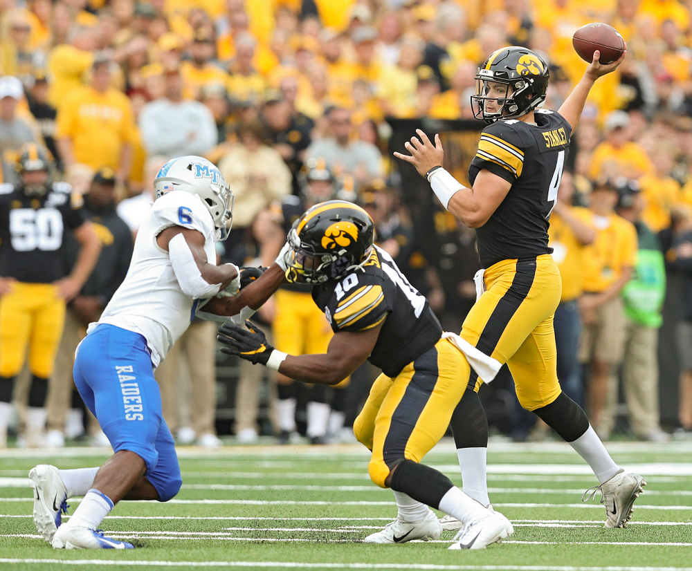 Iowa Hawkeyes quarterback Nate Stanley (4) throws a pass as running back Mekhi Sargent (10) blocks during the first quarter of their game at Kinnick Stadium in Iowa City on Saturday, Sep 28, 2019. (Stephen Mally/hawkeyesports.com)
