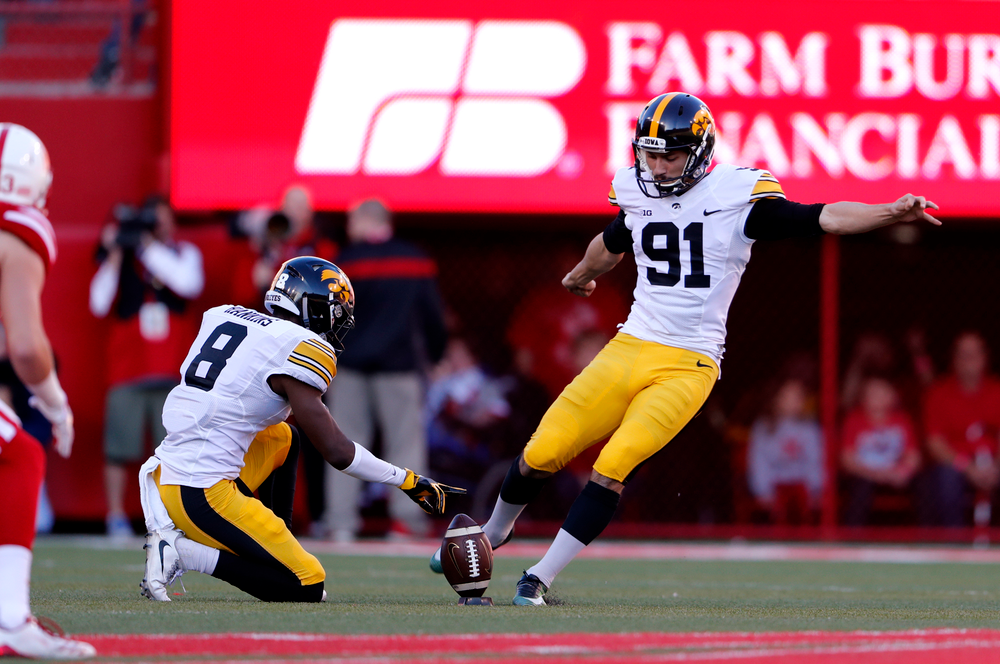 Iowa Hawkeyes place kicker Miguel Recinos (91) and defensive back Matt Hankins (8)