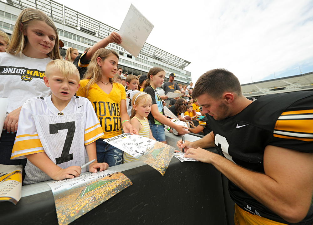 Iowa Hawkeyes place kicker Keith Duncan (3) signs an autograph during Kids Day at Kinnick Stadium in Iowa City on Saturday, Aug 10, 2019. (Stephen Mally/hawkeyesports.com)