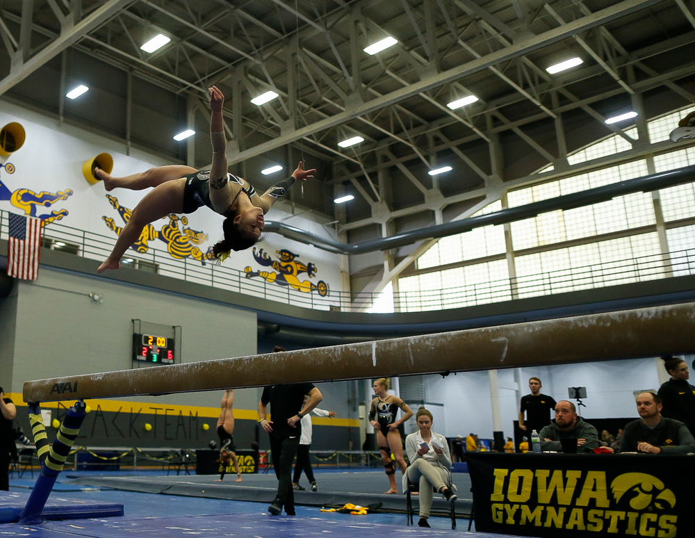 Misty Jade Carlson competes on the balance beam during the Black and Gold Intrasquad meet at the Field House on 12/2/17. (Tork Mason/hawkeyesports.com)