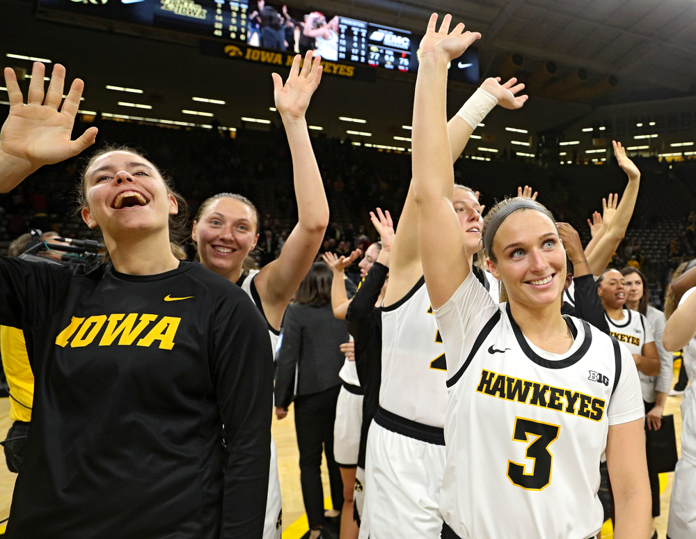 Iowa forward/center Paula Valiño Ramos (31), forward Amanda Ollinger (43), forward/center Monika Czinano (25), and guard Makenzie Meyer (3) wave to the crowd after their overtime win against Princeton at Carver-Hawkeye Arena in Iowa City on Wednesday, Nov 20, 2019. (Stephen Mally/hawkeyesports.com)