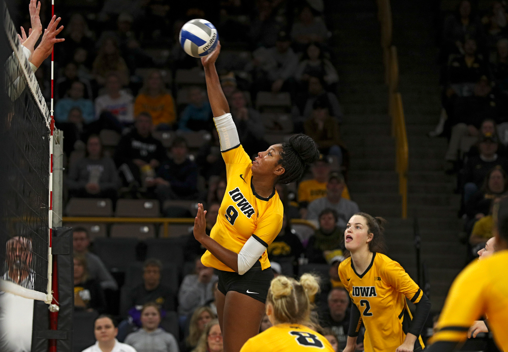 Iowa's Amiya Jones (9) lines up a shot during the first set of their match at Carver-Hawkeye Arena in Iowa City on Friday, Nov 29, 2019. (Stephen Mally/hawkeyesports.com)