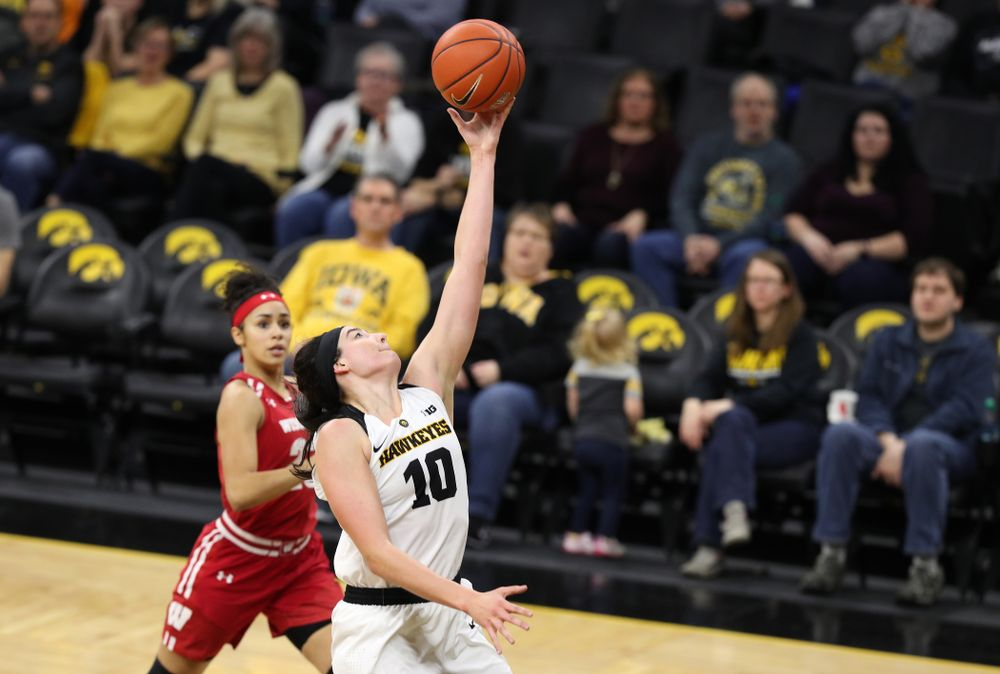 Iowa Hawkeyes forward Megan Gustafson (10) pulls down a pass against the Wisconsin Badgers Monday, January 7, 2019 at Carver-Hawkeye Arena.  (Brian Ray/hawkeyesports.com)