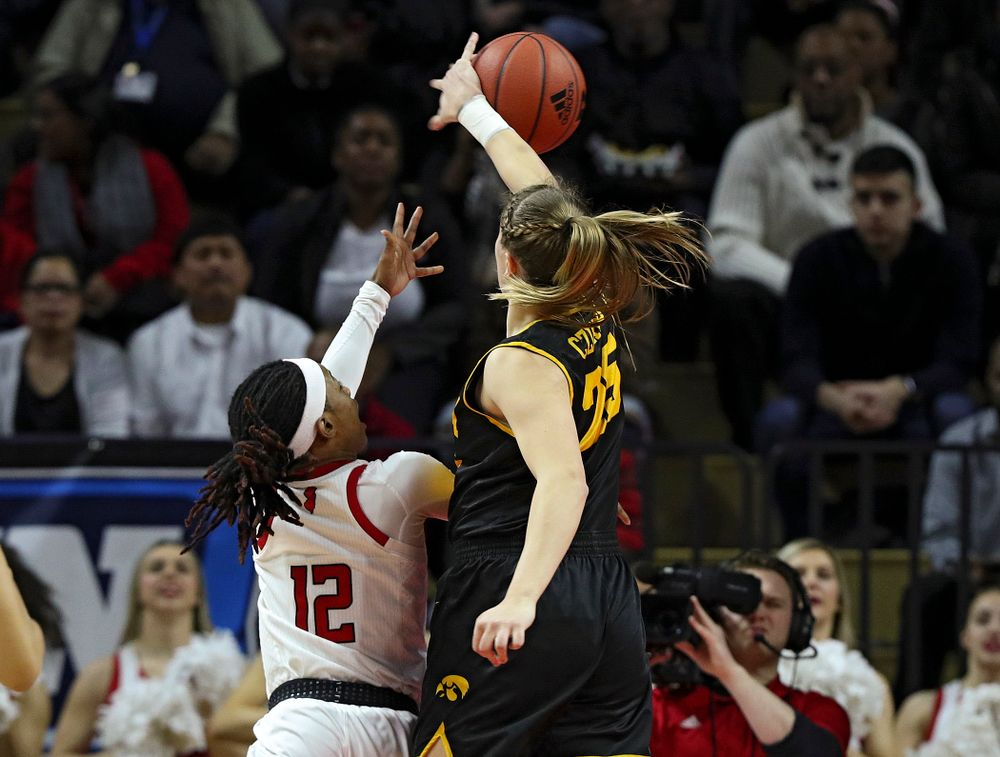 Iowa forward/center Monika Czinano (25) blocks a shot during the first quarter of their game at the Rutgers Athletic Center in Piscataway, N.J. on Sunday, March 1, 2020. (Stephen Mally/hawkeyesports.com)