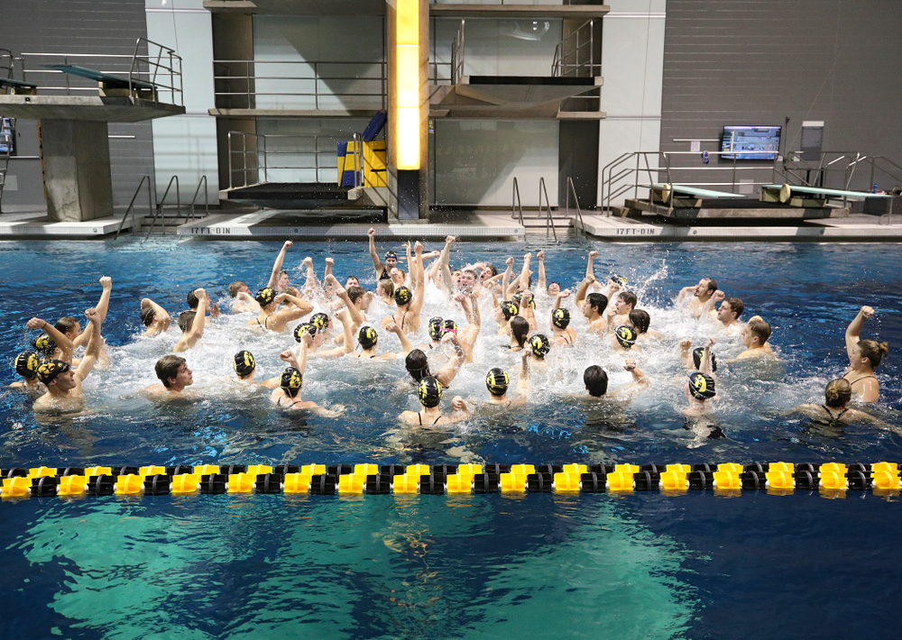 The Hawkeyes sing the Fight Song in the pool after their meet at the Campus Recreation and Wellness Center in Iowa City on Friday, February 7, 2020. (Stephen Mally/hawkeyesports.com)