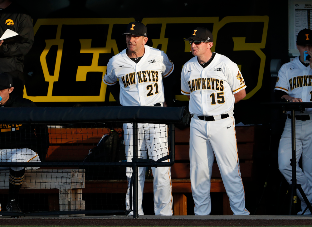 Iowa Hawkeyes head coach Rick Heller and associate head coach Marty Sutherland against the Michigan Wolverines Friday, April 27, 2018 at Duane Banks Field in Iowa City. (Brian Ray/hawkeyesports.com)