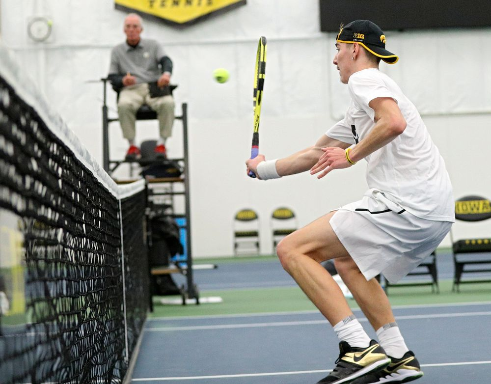 Iowa's Nikita Snezhko returns a shot at the net during his doubles match at the Hawkeye Tennis and Recreation Complex in Iowa City on Sunday, February 16, 2020. (Stephen Mally/hawkeyesports.com)