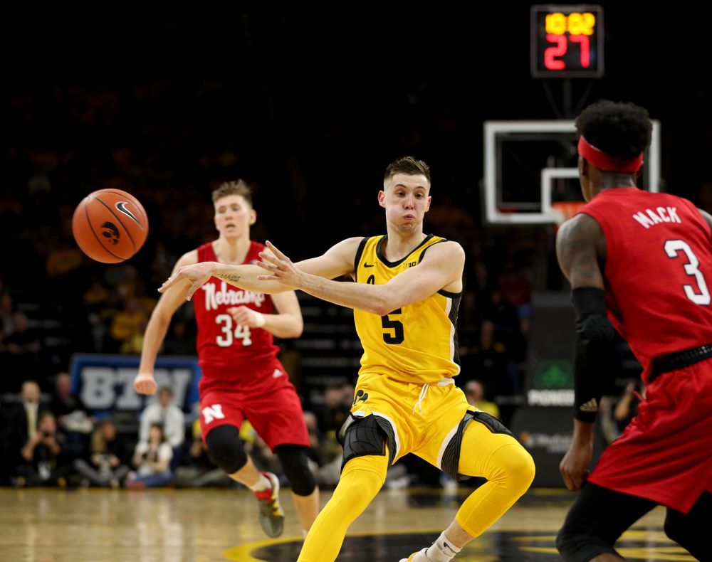 Iowa Hawkeyes guard CJ Fredrick (5) dishes off a pass against the Nebraska Cornhuskers Saturday, February 8, 2020 at Carver-Hawkeye Arena. (Brian Ray/hawkeyesports.com)