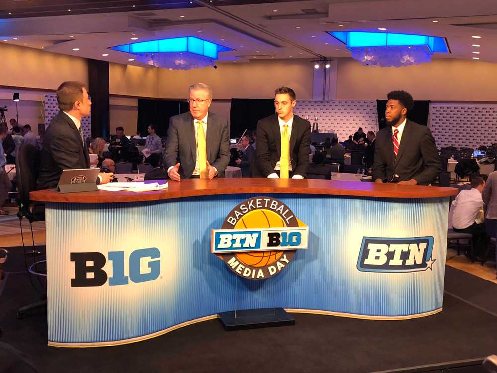 Dave Revsine, Fran McCaffery, Nicholas Baer, Isaiah Moss