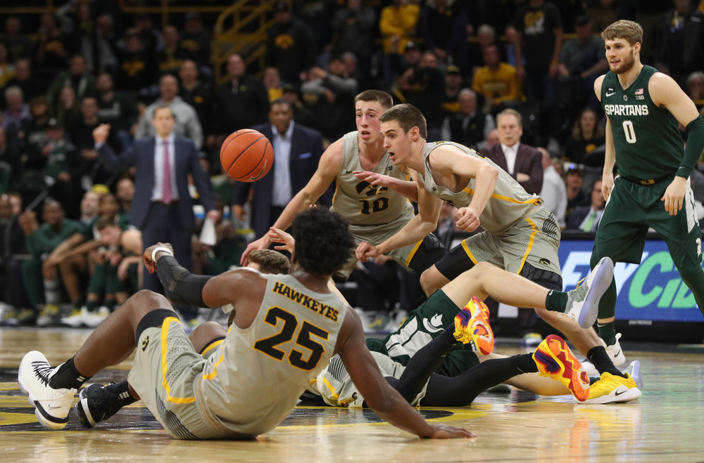Iowa Hawkeyes forward Nicholas Baer (51) and guard Joe Wieskamp (10) against the Michigan State Spartans Thursday, January 24, 2019 at Carver-Hawkeye Arena. (Brian Ray/hawkeyesports.com)