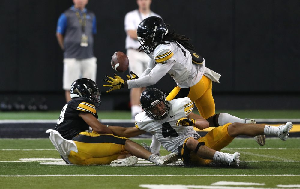Iowa Hawkeyes defensive back Devonte Young (17) and defensive back Dane Belton (4) During Fall Camp Practice No. 6 Thursday, August 8, 2019 at the Ronald D. and Margaret L. Kenyon Football Practice Facility. (Brian Ray/hawkeyesports.com)