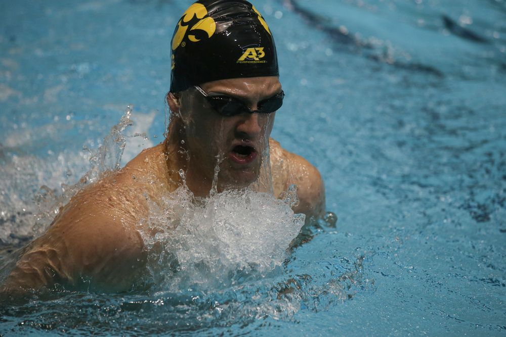 Iowa's Caleb Babb swims the 100-yard breaststroke during the Iowa swimming and diving meet vs Notre Dame and Illinois on Saturday, January 11, 2020 at the Campus Recreation and Wellness Center. (Lily Smith/hawkeyesports.com)
