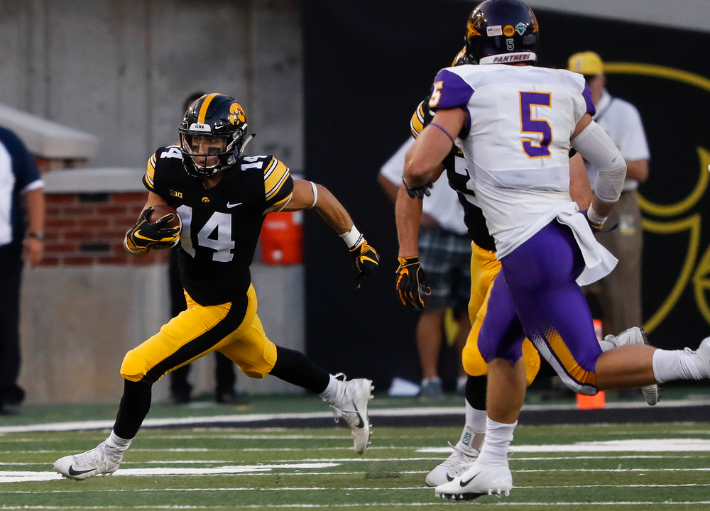 Iowa Hawkeyes wide receiver Kyle Groeneweg (14) returns a punt during a game against Northern Iowa at Kinnick Stadium on September 15, 2018. (Tork Mason/hawkeyesports.com)