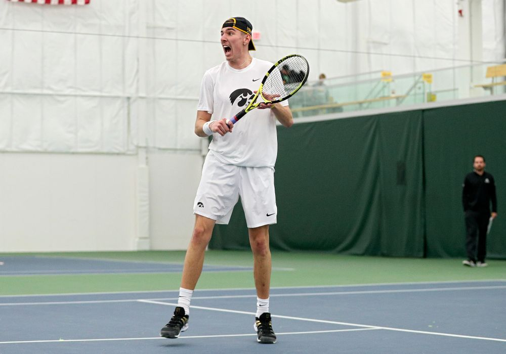Iowa's Nikita Snezhko celebrates a point during his doubles match at the Hawkeye Tennis and Recreation Complex in Iowa City on Sunday, February 16, 2020. (Stephen Mally/hawkeyesports.com)