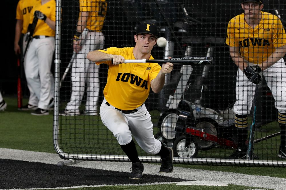 Iowa Hawkeyes outfielder Justin Jenkins (6) puts down a bunt during practice Thursday, February 6, 2020 at the Indoor Practice Facility. (Brian Ray/hawkeyesports.com)