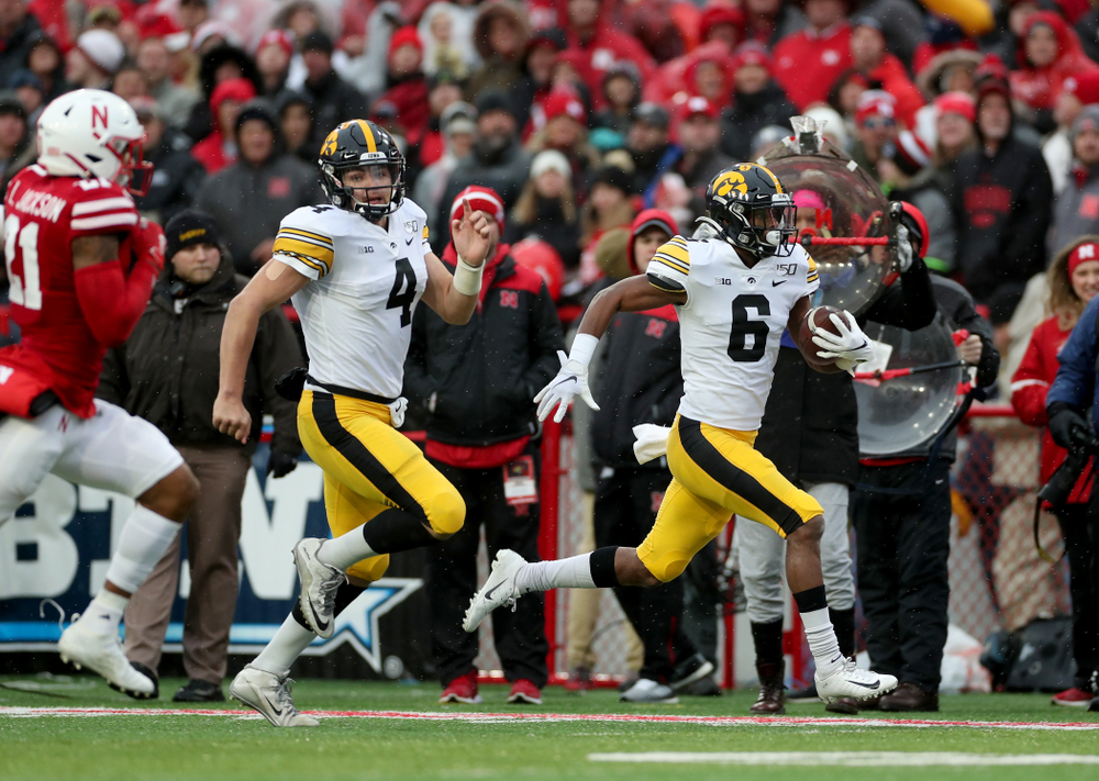 Iowa Hawkeyes quarterback Nate Stanley (4) blocks for wide receiver Ihmir Smith-Marsette (6) on his way to a touchdown against the Nebraska Cornhuskers Friday, November 29, 2019 at Memorial Stadium in Lincoln, Neb. (Brian Ray/hawkeyesports.com)
