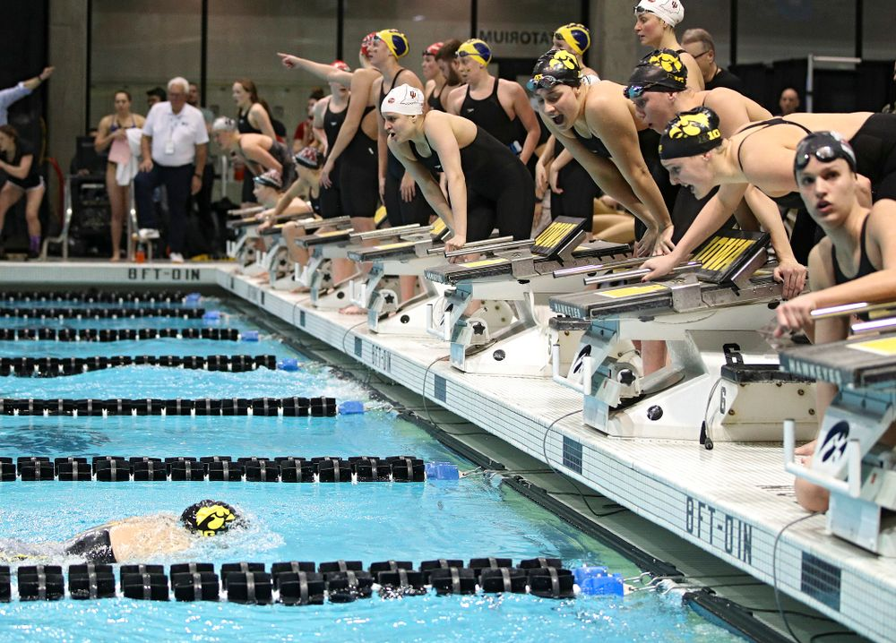 Iowa's Macy Rink is urged on by teammates Hannah Burvill, Allyssa Fluit, and Emilia Sansome as she swims the 800 yard freestyle relay event during the 2020 Big Ten Women's Swimming and Diving Championships at the Campus Recreation and Wellness Center in Iowa City on Wednesday, February 19, 2020. (Stephen Mally/hawkeyesports.com)