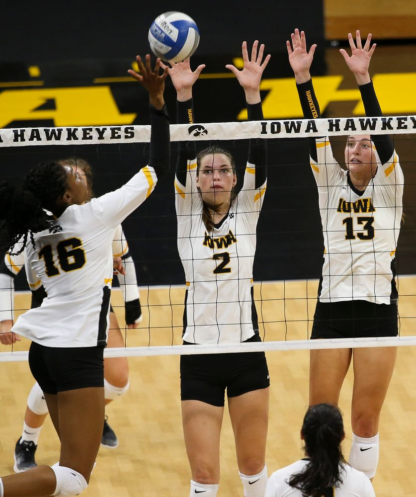 Iowa Hawkeyes setter Courtney Buzzerio (2), Iowa Hawkeyes middle blocker Sara Wing (13)