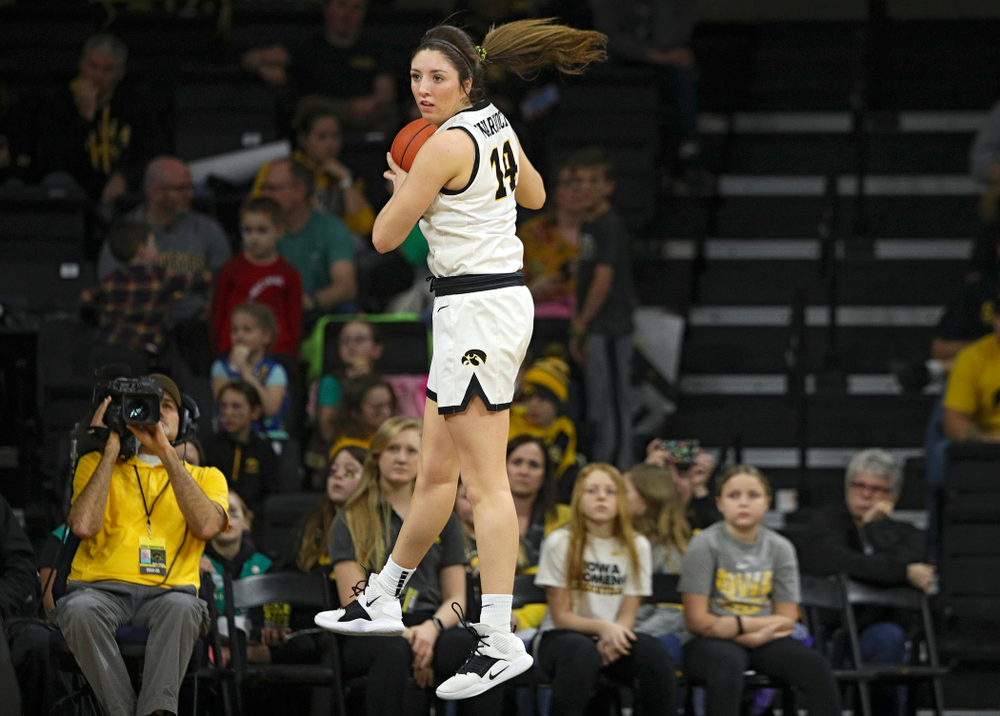 Iowa Hawkeyes guard Mckenna Warnock (14) pulls down a rebound during the third quarter of their game at Carver-Hawkeye Arena in Iowa City on Sunday, January 26, 2020. (Stephen Mally/hawkeyesports.com)