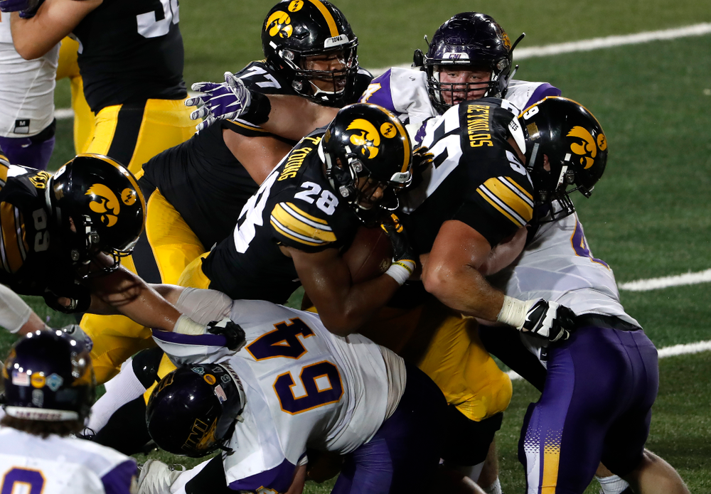 Iowa Hawkeyes running back Toren Young (28) and offensive lineman Ross Reynolds (59) against the Northern Iowa Panthers Saturday, September 15, 2018 at Kinnick Stadium. (Brian Ray/hawkeyesports.com)