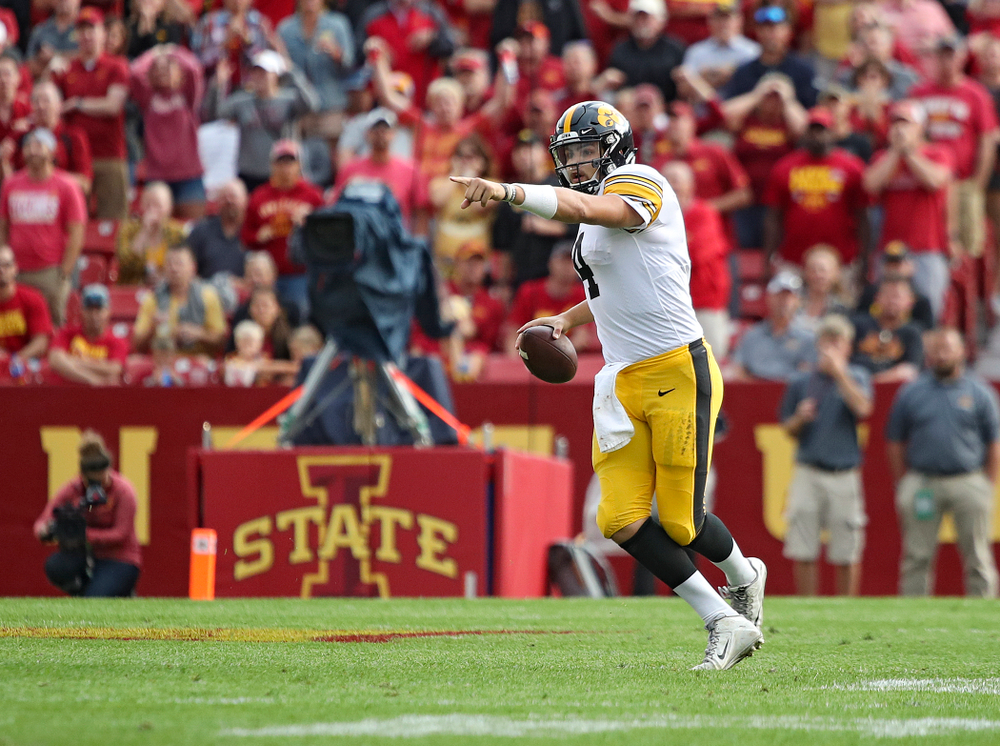 Iowa Hawkeyes quarterback Nate Stanley (4) points as he looks to pass during the second quarter of their Iowa Corn Cy-Hawk Series game at Jack Trice Stadium in Ames on Saturday, Sep 14, 2019. (Stephen Mally/hawkeyesports.com)