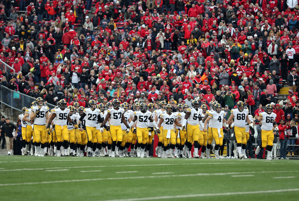 The Iowa Hawkeyes swarm onto the field against the Wisconsin Badgers Saturday, November 9, 2019 at Camp Randall Stadium in Madison, Wisc. (Brian Ray/hawkeyesports.com)