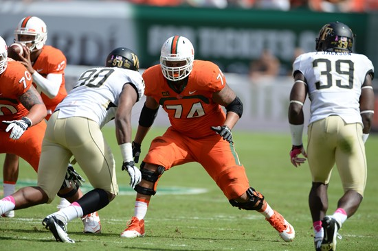 University of Miami Hurricanes offensive lineman Ereck Flowers #74 gets set to block against the Wake Forest Demon Deacons at Sun Life Stadium on...
