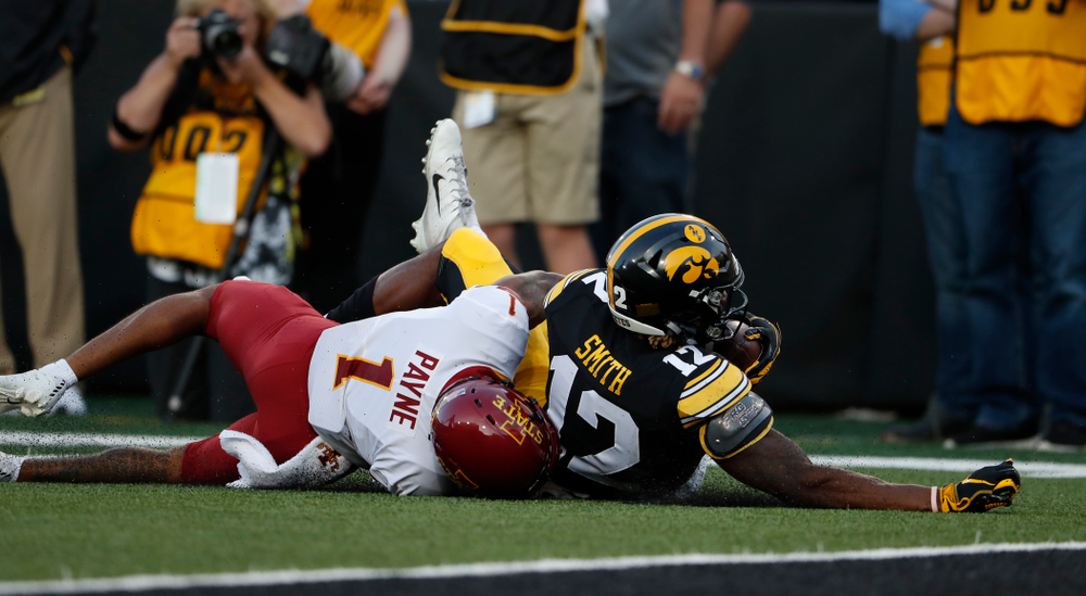 Iowa Hawkeyes wide receiver Brandon Smith (12) picks up a first down against the Iowa State Cyclones Saturday, September 8, 2018 at Kinnick Stadium. (Brian Ray/hawkeyesports.com)
