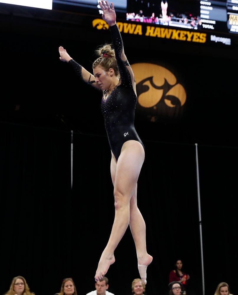 Iowa's Sydney Hogan competes on the beam
