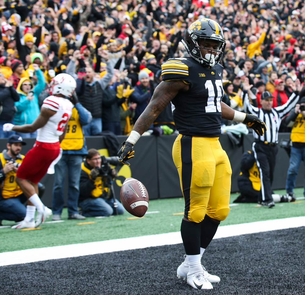 Iowa Hawkeyes running back Mekhi Sargent (10) celebrates after scoring a touchdown during a game against Nebraska at Kinnick Stadium on November 23, 2018. (Tork Mason/hawkeyesports.com)