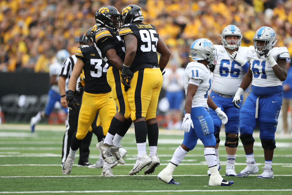 Iowa Hawkeyes defensive lineman Cedrick Lattimore (95) and linebacker Djimon Colbert (32) against Middle Tennessee State Saturday, September 28, 2019 at Kinnick Stadium. (Max Allen/hawkeyesports.com)