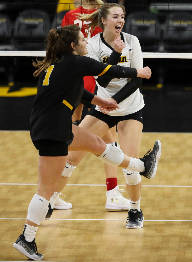 Iowa Hawkeyes defensive specialist Molly Kelly (1) and Iowa Hawkeyes outside hitter Meghan Buzzerio (5) celebrate after winning a point during a match against Maryland at Carver-Hawkeye Arena on November 23, 2018. (Tork Mason/hawkeyesports.com)