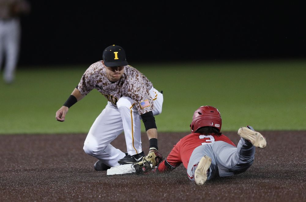 Iowa Hawkeyes Tanner Wetrich (16) tags out a runner at second against the Nebraska Cornhuskers on Military Appreciation Night Friday, April 19, 2019 at Duane Banks Field. (Brian Ray/hawkeyesports.com)