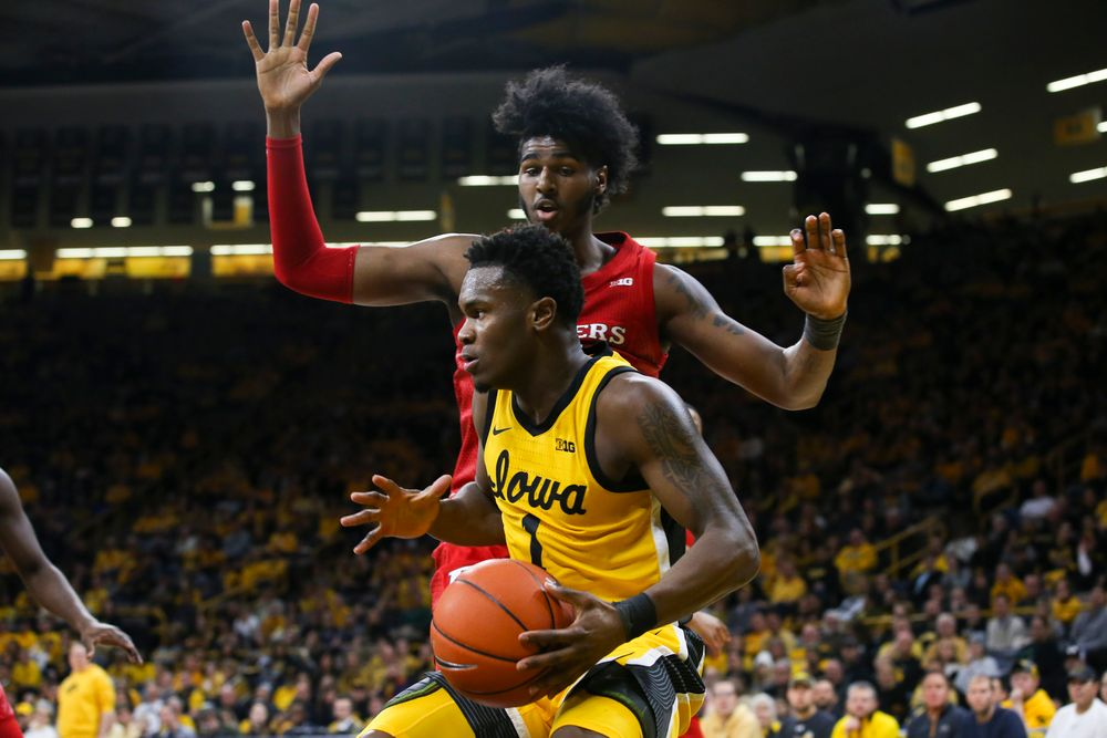Iowa Hawkeyes guard Joe Toussaint (1) looks to pass the ball during the Iowa men's basketball game vs Rutgers on Wednesday, January 22, 2020 at Carver-Hawkeye Arena. (Lily Smith/hawkeyesports.com)