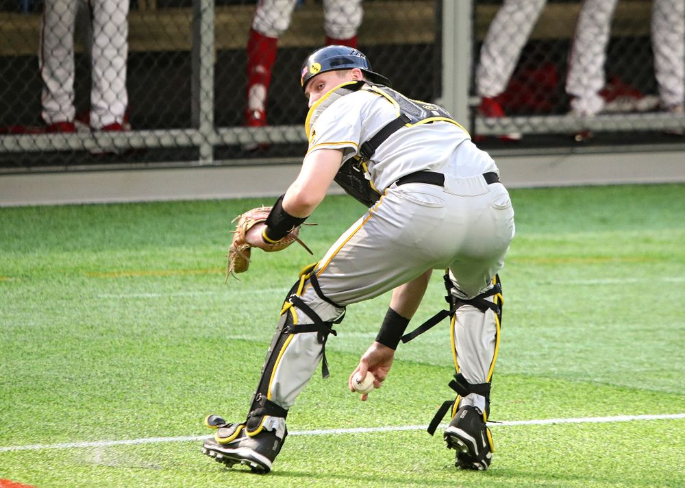 Iowa Hawkeyes catcher Brett McCleary (32) fields a bunt during the seventh inning of their CambriaCollegeClassic game at U.S. Bank Stadium in Minneapolis, Minn. on Friday, February 28, 2020. (Stephen Mally/hawkeyesports.com)